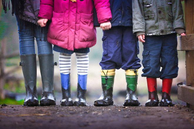 Four children holding hands