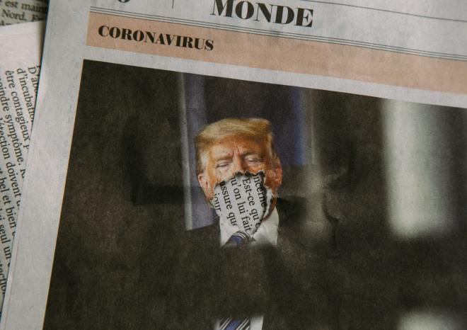 President Donald Trump and a newspaper clipping of the coronavirus