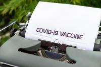 Typewriter with COVID-19 vaccine text on a piece of paper