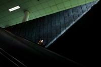 Lady going down an escalator (Photo by Ng Shi Wen)