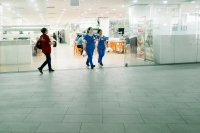Nurses in blue walking out of a food court (Photo by Ng Shi Wen)