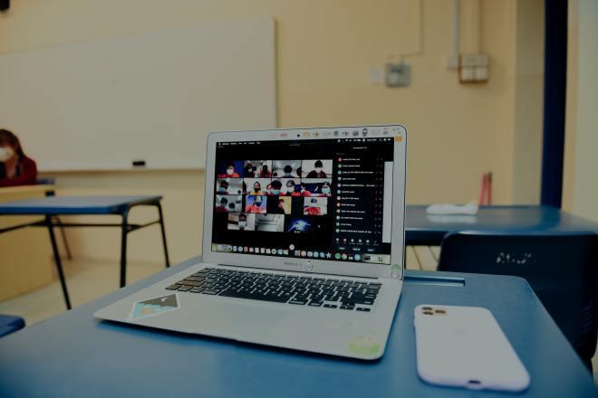 Laptop on desk (Photo by lucas law on Unsplash)